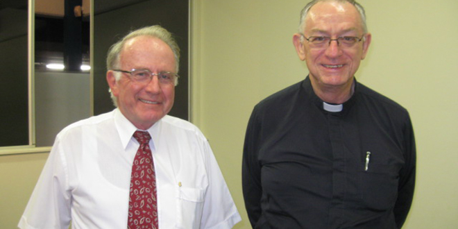 Seeking unity: Reverend David Gill, of the Uniting Church, with Bishop Michael Putney of Townsville at the launch of a report of the national dialogue between the Roman Catholic Church and the Uniting Church in Australia