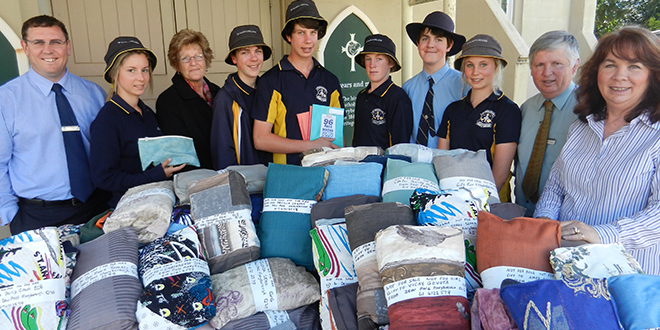 Giving time and talent: (From left) Acting principal at St Mary's College, Maryborough, Dan Lourigan; Prue Beauchamp; Lorraine Hogan, of Boltons; Alex Kunst; Jack Hansen; Mason Atkinson; Danny Moller; Lillian Strack; acting deputy principal Bradley Banney; and Pat Burkett all helped with the latest Sew PNG project