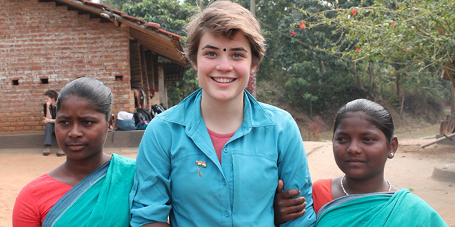 Faith journey: Ally Lynch with the local villagers on her recent trip to India