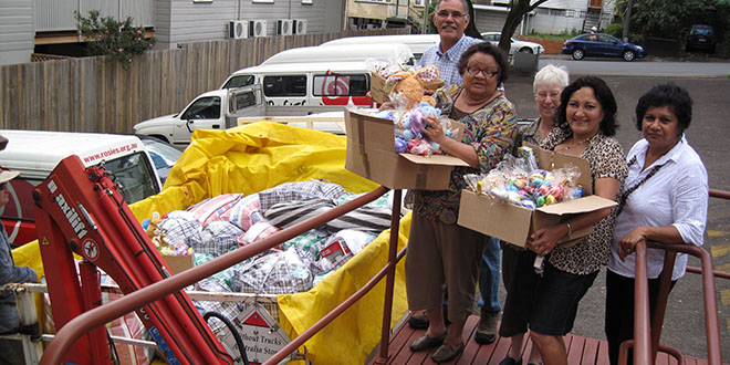 Helping hands: Loading boxes for the Easter delivery to indigenous families affected by Brisbane's 2011 floods are (from left) Uncle David Miller, Aunty Judy Brown, Josephite Sister Kay McPadden, Ravina Waldren and Bernadette Jeffrey.