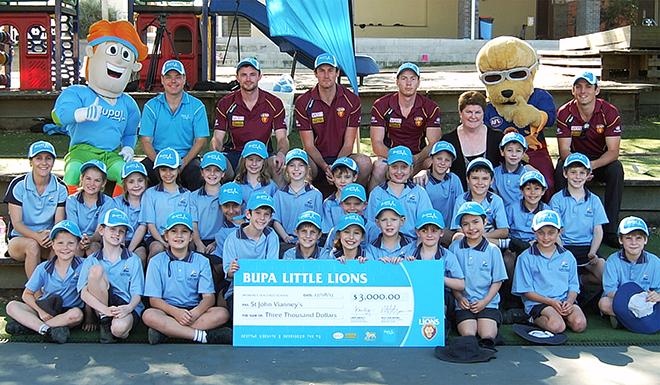 Teacher Tracy Morris and her Year 3 students with representatives of the Brisbane Lions.