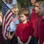 Norris Lenartowicz, centre, a kindergarten student at St Agnes School in Avon, New York stands with his classmates during a remembrance ceremony for the September 11, 2001, terrorist attacks.
