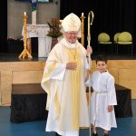 Archbishop Mark Coleridge appreciated the efforts of Prep student Sean Ranieses who served during the Thanksgiving Mass.