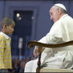 Little boy makes himself at home on stage with Pope
