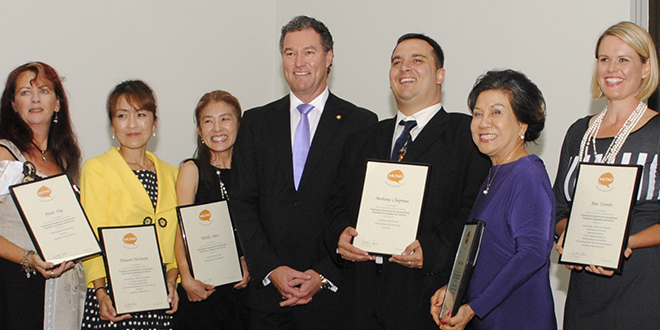 Rice day: Masumi Morimoto (second from left) receives her award in Brisbane. She is with State Minister for Education, Training and Employment, John-Paul Langbroek (fourth from left) and other award recipients.