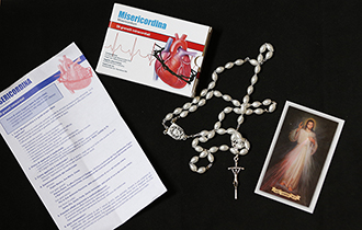 Box containing rosary, Divine Mercy holy card and medicinal-style instruction sheet pictured at Vatican
