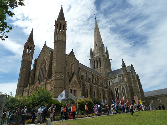 Pilgrims make their way into Sacred Heart Cathedral, Bendigo at the end of the annual Christus Rex pilgrimage.