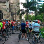 Cyclists gathering outside St Stephen's Cathedral to receive a blessing of protection before making a 45km journey to Ipswich.