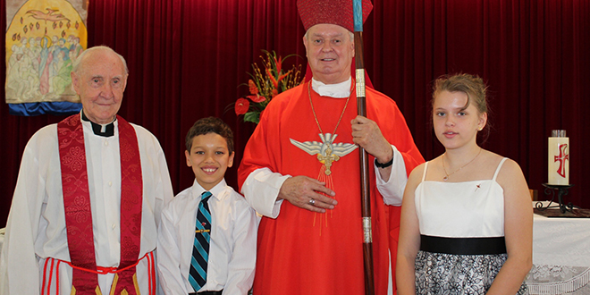 Retired priest Fr Joe Flannery, Carl Martin, Bishop Brian Finnigan and Naomi McClarty celebrating the Confirmation day of the young parishioners