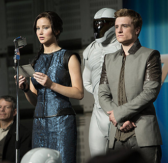 Josh Hutcherson and Jennifer Lawrence star in the movie The Hunger Games: Catching Fire