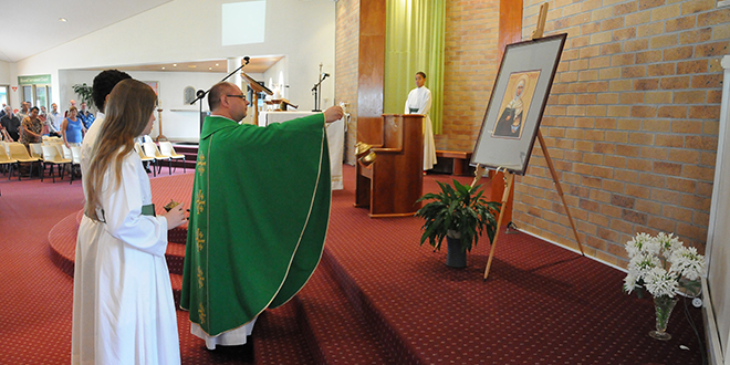 Fr Rucinski blessing the icon of St Brigid of Ireland.