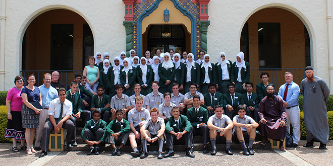 Padua College students sitting with students from Islamic College of Brisbane during their recent visit.