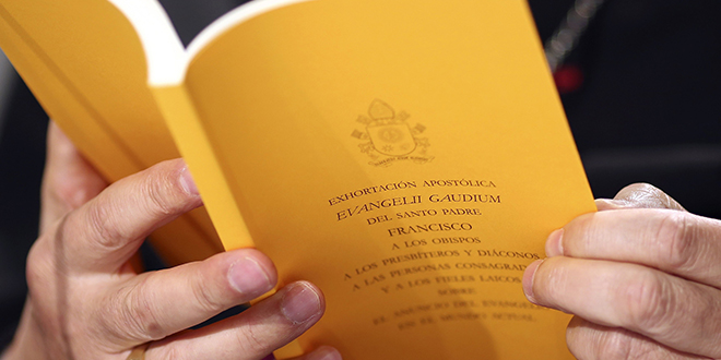 Copy of apostolic exhortation 'Evangelii Gaudium' seen during presentation at Vatican