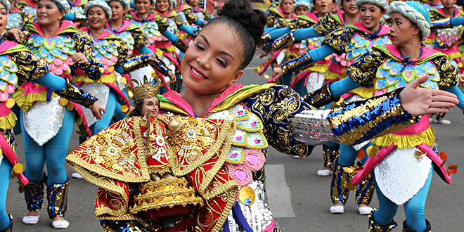 Thousands of Filipino Catholics dance and cheer through the streets of Cebu to mark the Feast Day of the Infant Child Jesus, known locally as Santo Nino.