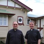 Brisbane Oratory members Fr Adrian Sharp and Fr Paul Chandler outside the Oratory community's house.
