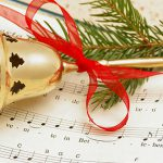 Christmas sheet music and bell