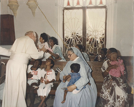 Pope John Paul II visiting young disabled children from the poorest families in Chennai being cared for at Mithra, with Sr Mary Theodore, its founder.
