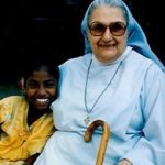 Sr Mary Theodor with disabled child at Mithra