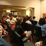 The crowd listens intently to Fr Anthony Ekpo's talk at Faith on Tap on Monday night.
