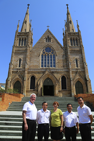 Ipswich's new pastoral team includes new administrator and dean of the South Country deanery Fr Peter Dillon, Rosewood's new parish priest Fr John Hong, pastoral program co-ordinator and long-time parishioner Bernadette McAndrews, continuing Ipswich priest Fr Joseph Liem and Brisbane's newly ordained priest Fr Neville Yun, standing in front of St Mary's, Ipswich.