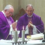 Seminary rector Monsignor Tony Randazzo concelebrates Mass with Pope Francis