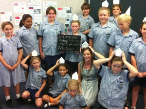 Message of love: Year 5 students at St Joseph's School, Cloncurry, and their teacher send a get-well message to Bishop Putney after news of his cancer diagnosis.