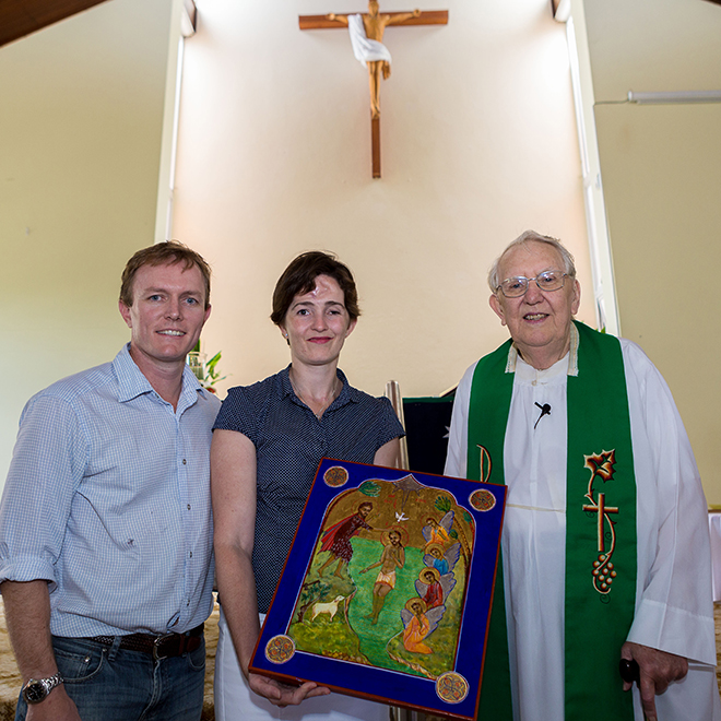 Grateful for support: Dr Andrew Burke and Dr Zara Weedon presenting an icon to 	Gordon Park pastor emeritus Fr Terry Madden last Sunday. Photo: Alan Edgecomb