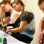 Promising guitarists learn how to play with reverence and skill during a music workshop at Ignite School of Music.