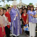Jubilant faces: Brisbane Archbishop Mark Coleridge gathers with many Filipino Catholics who attend Mass at Miami and Burleigh Heads