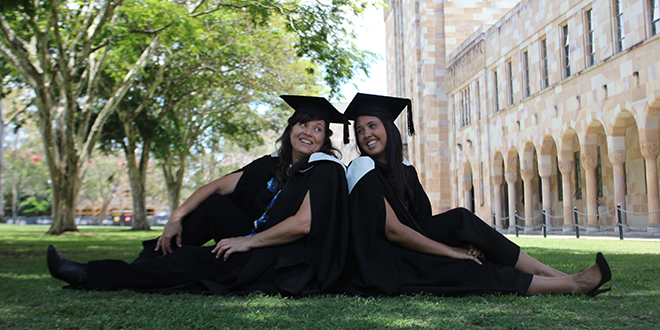 Mary Daly and daughter Maddie celebrate their graduation at the University of Queensland