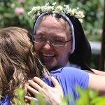 Sr Catherine Ann Therese celebrates with a well-wisher