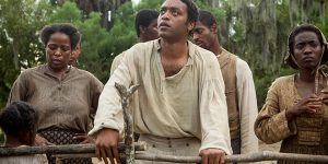 """Into slavery: Chiwetel Ejiofor (centre) stars in a scene from the movie """"12 Years a Slave"""".  Photo: CNS/Fox Searchlight"""