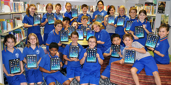 Technology boost: Year 5 students with their iPads at Our Lady of Dolours School, Mitchelton.
