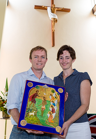 Andrew and Zara with the icon which now hangs to one side of the altar.