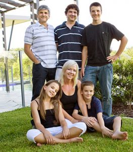 Robert Falzon with his wife Alicia and family.