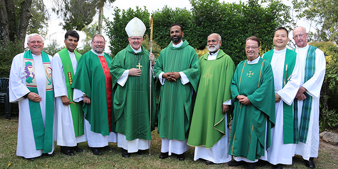 Parish leader: Fr David Batey, Divine Word Missionary Father Sunil Nagothu,  Fr Michael McKeaten, Archbishop Mark Coleridge, Fr Joseph 	Kannatt,  MCBS provincial superior Fr Joseph Mulangattil, Monsignor Peter Meneely, Fr Neville Yun, and Fr Ray O'Leary at the installation Mass. Photo: Emilie Ng