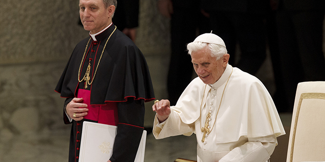 Pope Benedict greets the crowd as he begins a general audience in Paul VI hall with prefect of the papal household and the pope's personal secretary Archbishop Georg Ganswein watching on. Photo: CNS/L'Ossevatore Romano via Reuters