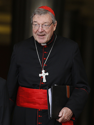 Cardinal George Pell of Sydney leaves a meeting of cardinals with Pope Francis in the synod hall at the Vatican Feb. 20. The Vatican announced Feb. 24 that Cardinal Pell has been appointed by Pope Francis to head a new Vatican office overseeing Vatican finances. (CNS photo/Paul Haring).