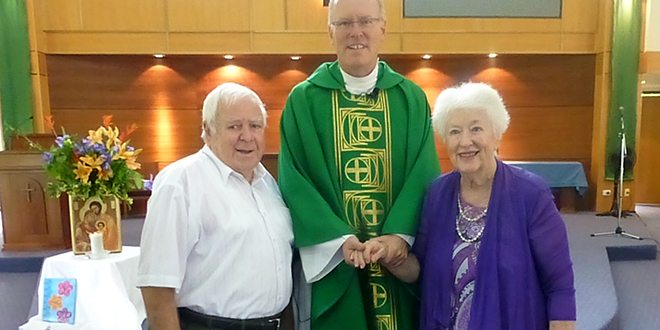 Faithful witness: Claude and Maureen Hayson with Fr Ken Howell. The couple celebrated their 67th wedding anniversary at this year's World Marriage Day Mass at St Benedict's Church, Mudgeeraba.