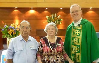 John and Iris Morgan, celebrating their 60th wedding anniversary, with Fr Ken Howell.