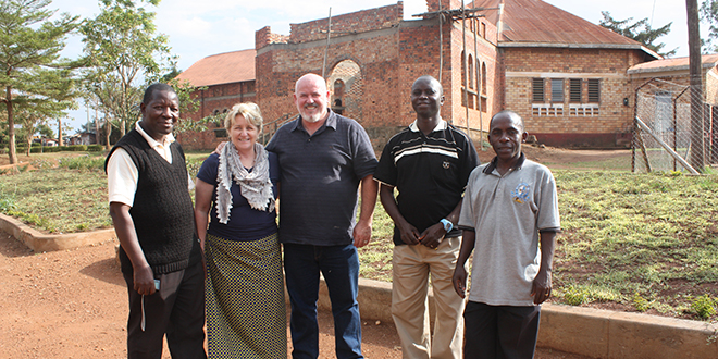 Kingdom building: St Bruno's parish priest Fr Porphyrius, Linda Brady, John Brady and Ugandan parishioners Aloysius and Leonard 	outside the new church being built.