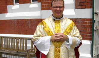 Centenary: St Columba's associate pastor Fr Michael Grace celebrated a high Mass wearing vestments from the early days of the parish life.
