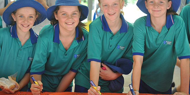 Signature deal: Year 7 students Emma Wilson, Lilyan Jennens, Jorgia Mowbray and Roisin Wallace-Nash, of Southern Cross Catholic College, Scarborough, pledge against bullying on March 21.