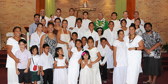 Cultural Mass: Fr Eparti Tamarti with many of the children and organisers at the Samoan Mass at St Brigid's Church, Nerang.