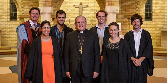 New year: At the ACU Commencement Mass are (from left) Associate Vice Chancellor Jim Nyland, student association president Natalie Vickers, representative Patrick Griffin, Archbishop Mark Coleridge, association vice-president Matthew Bibo, and representatives Grace Dewsnap and Ben Turner.