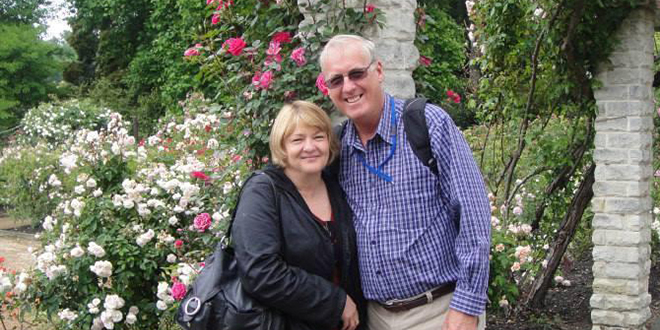 In hope: Family members of Brisbane couples Mary and Rodney Burrows (pictured riight) and Bob and Cathy Lawton who were on board missing Malaysian flight MH370 prayed for those on the flight. Photo: AAP