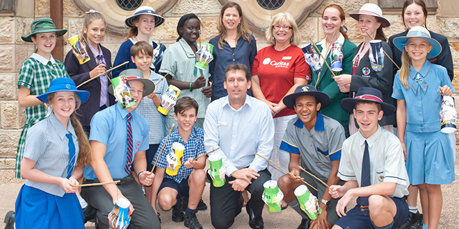 Casting light: With students after an activity making lanterns from old Project Compassion posters are (front centre) Caritas Australia diocesan director Joe Foley and (back centre, in blue) Latin America program co-ordinator Siobhan Jordan and global education advisor Susan Bentley. The annual campaign  was launched in Brisbane on March 4. Photo: kissphotography.