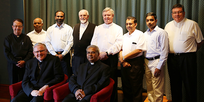 Aid from India: Missonary Congregation of the Blessed Sacrament superior general Fr George Kizhakkemury (seated right) met at Wynberg with clergy from the Brisbane archdiocese looking after the order's priests.  At the gathering are Archbishop Mark Coleridge (seated left), and (standing from left) Monsignor Peter Meneely, Fr Joe Thottankara, Fr Joseph Kanatt, Bishop Joseph Oudeman, Bishop Brian Finnigan, Fr Jacob Chacko, Fr Noyichan Mamoottil and Fr Michael McCarthy.