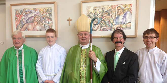 Blessed day: Fr Dan Carroll, Hamish Walsh, Bishop Brian Finnigan, Brisbane artist Cees Sliedrecht, and Joshua Sutton.