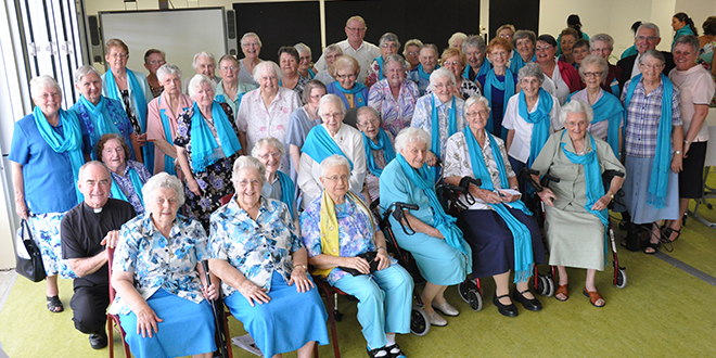 Anniversary marked: Josephite Sisters gather after enjoying a morning tea at Nundah's Mary MacKillop College to mark the 50th anniversary of the order's involvement in secondary teaching in Queensland. Also present are Fr Bernie Gallagher (front left), Fr John Begg (back centre) and college principal Niall Coburn (back second from right).